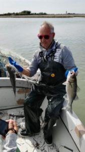Burano pecheur sur son bateau